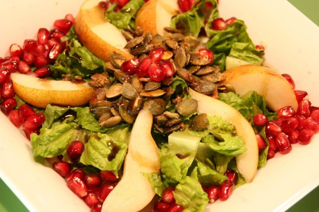 Pears, Pumpkinseeds and Pomegranates adorn this Salad