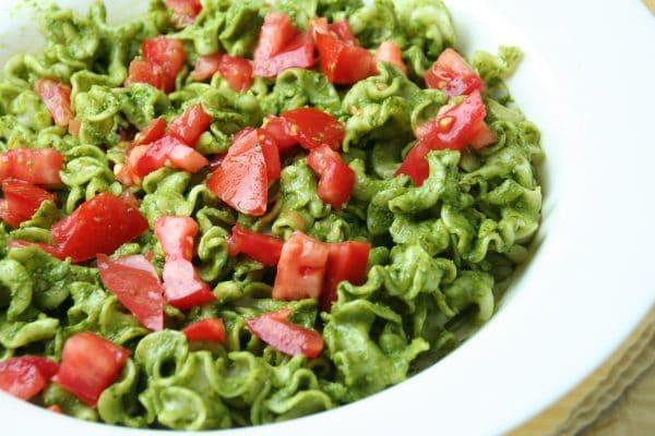 Gluten-free fusillo with pesto and tomatoes