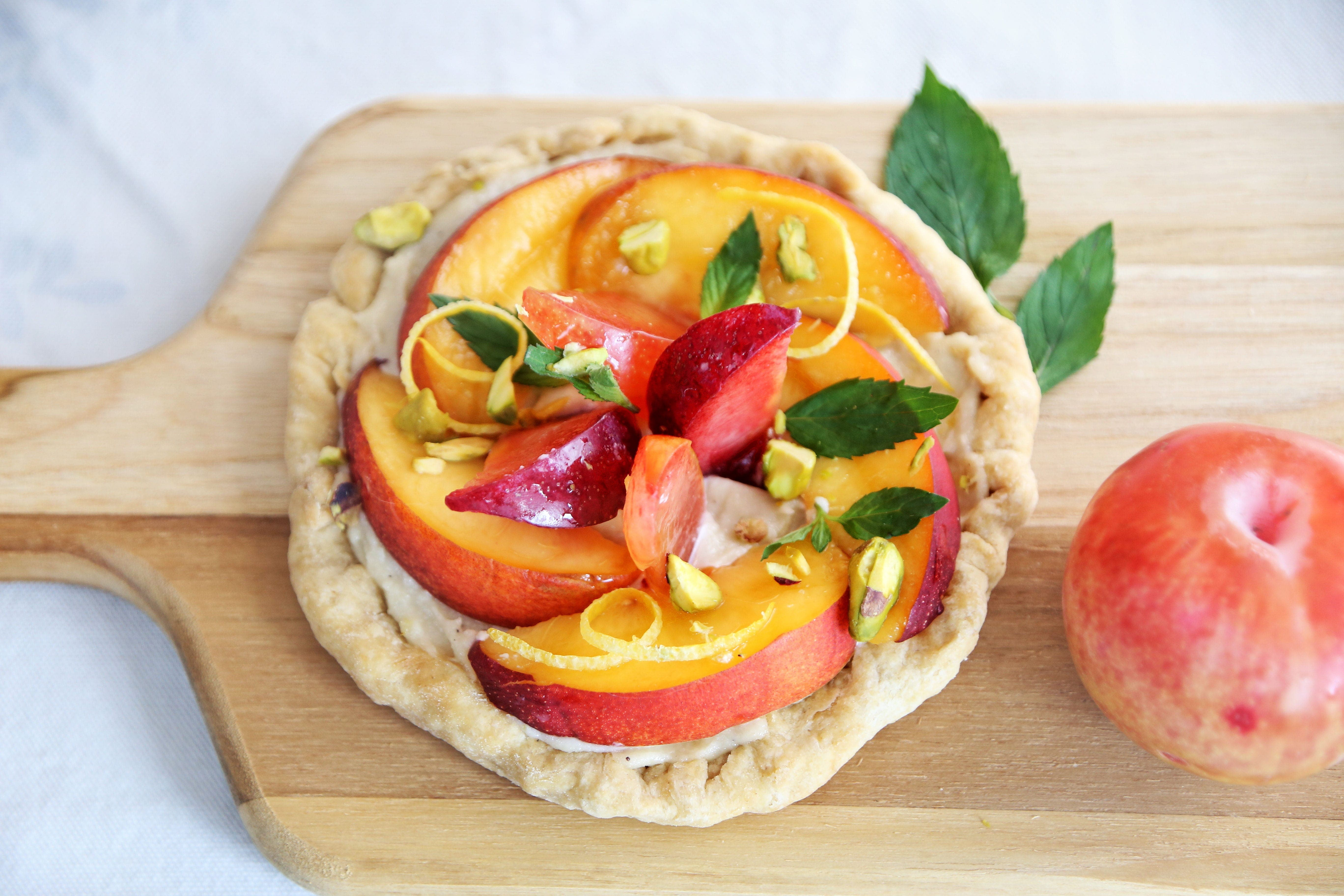 Sweet Nectarines top a Fresh Fruit Tart with Lemony Cream